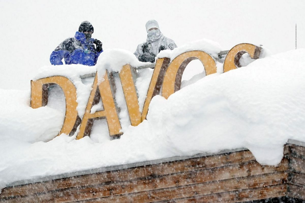 Security officers holding their position on the roof of a hotel during the World Economic Forum in Davos, Switzerland on Jan 22, 2018.