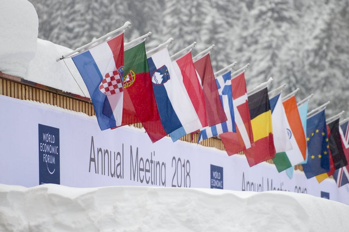 Flags from participating countries and regions hang outside the congress centre on the eve of the 48th World Economic Forum, on Jan 22, 2018.