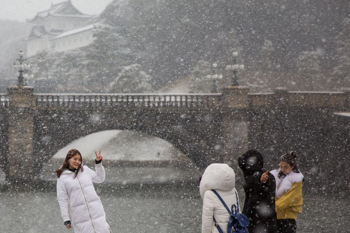 Snow falls over the Imperial Palace in Tokyo, Japan, on Jan 22, 2018.