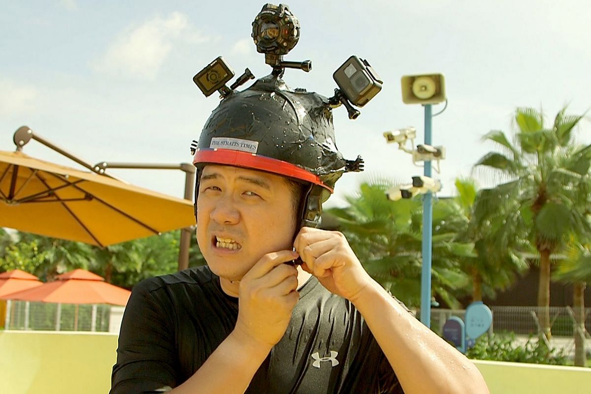 The Straits Times' Trevor Tan trying out the action cameras at Wild Wild Wet water park.