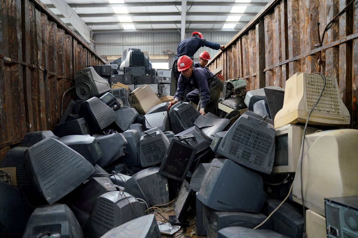 Monitors about to be recycled are seen in a warehouse at the government-sponsored recycling park in the township of Guiyu, Guangdong Province, China January 12, 2018.
