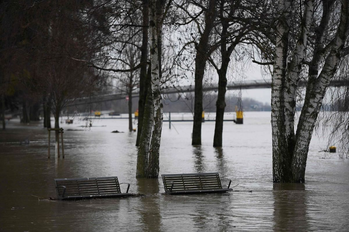 A picture taken in Kehl, at the French-German border on Jan 23, 2018, shows flooded benches after the Rhine river burst its banks due to torrential rains. The Rhine threatened to overflow and the rapidly rising Seine forced Paris authorities to halt