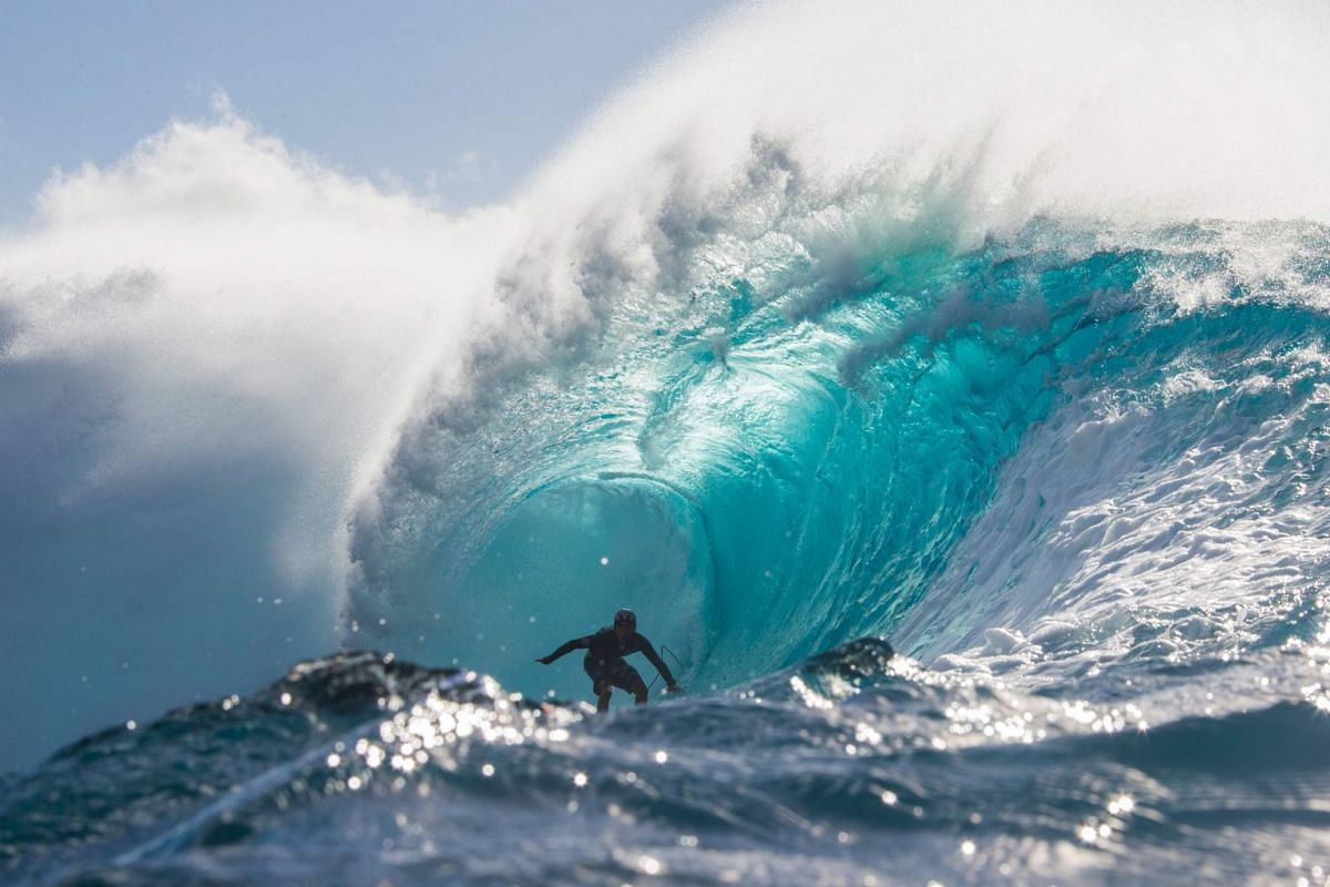Japanese surfer Wakita Takayuki rides the barrel during a late afternoon free surf session at the legendary Banzai Pipeline on the North shore of Oahu, Hawaii, on Jan 22, 2018.