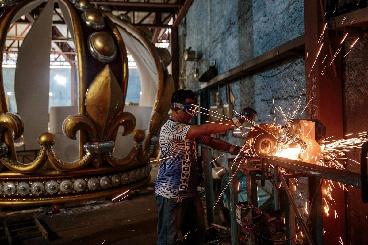 A worker welds iron while creating an allegorical car for a Carnival parade at a samba school studio in Sao Paulo, on Jan 12, 2018.