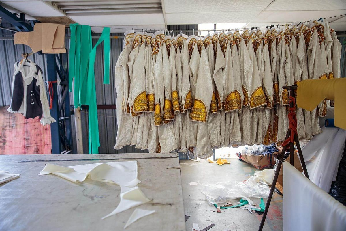 Costumes for a Carnival parade hang on a wire at a samba school studio in Sao Paulo, on Jan 12, 2018.