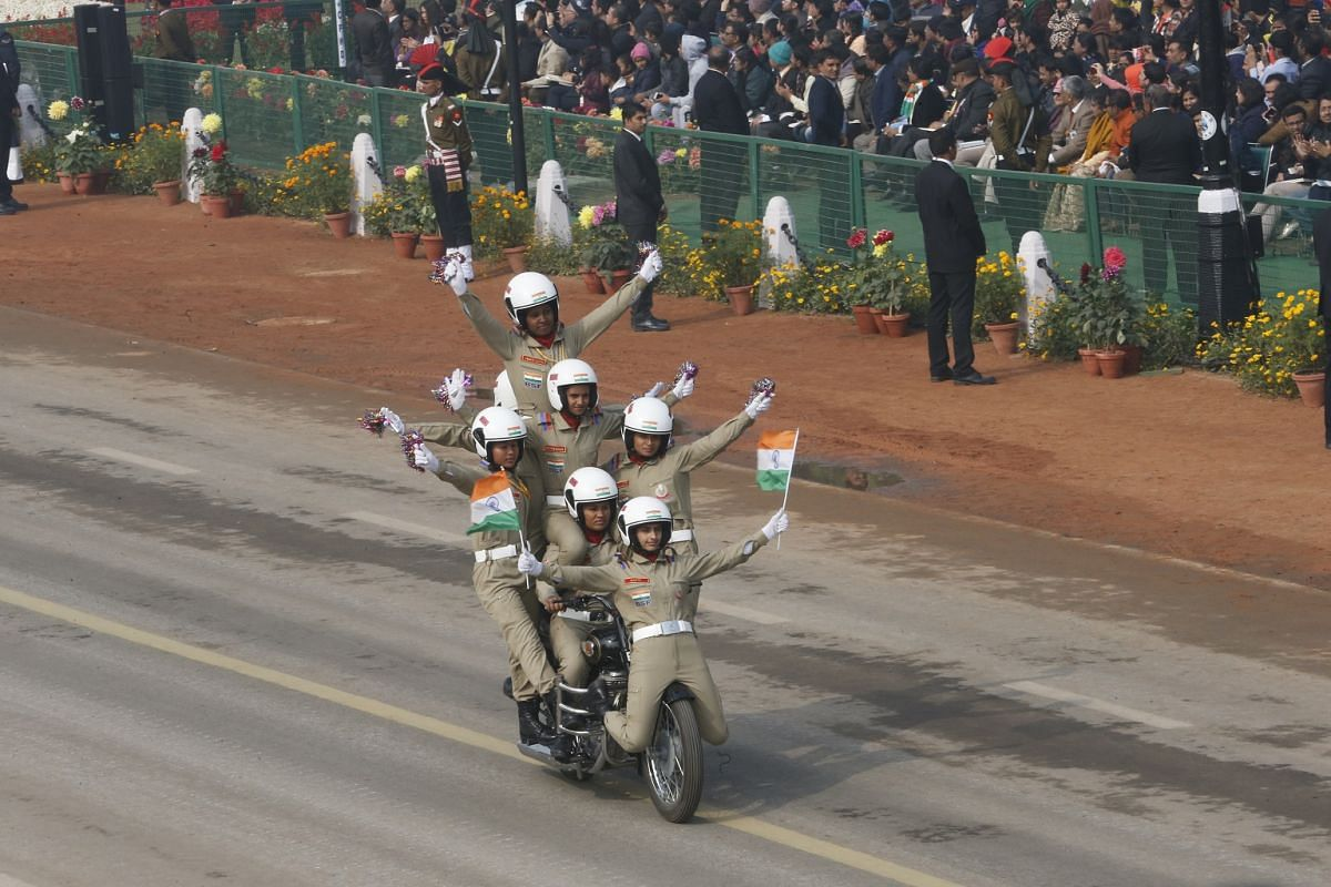 Female motorcycle riders from the Indian Border Security Force (BSF) perform stunts during the Republic Day parade in New Delhi.