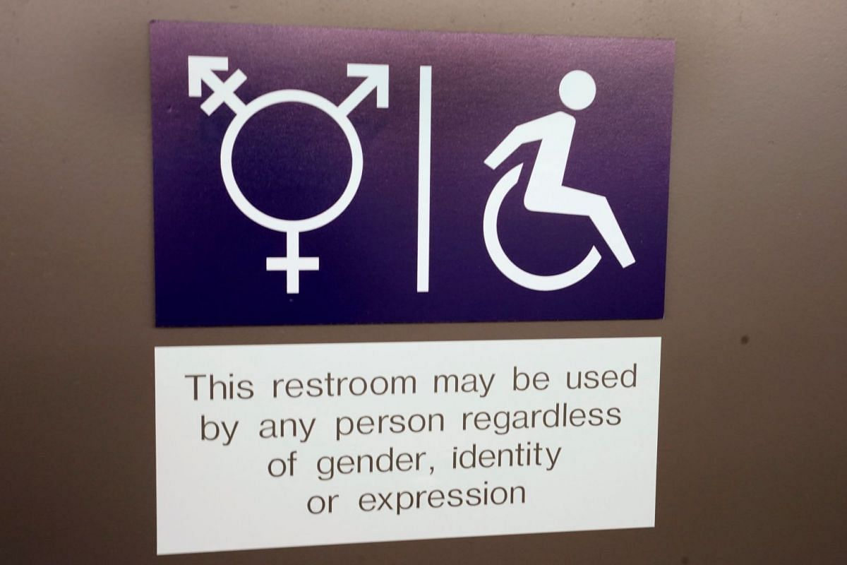 A sign is seen on a gender neutral toilet during the World Economic Forum annual meeting in Davos, on Jan 26, 2018.