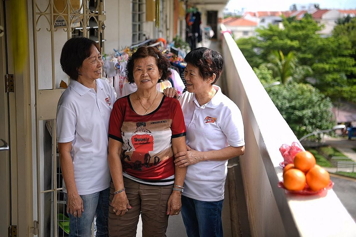 Madam Wong Yoke Hun (far left) and Madam Ng Geok Thuay are volunteer befrienders who regularly visit senior neighbours such as Madam Tan Ah Hiang (centre) to chat with them.