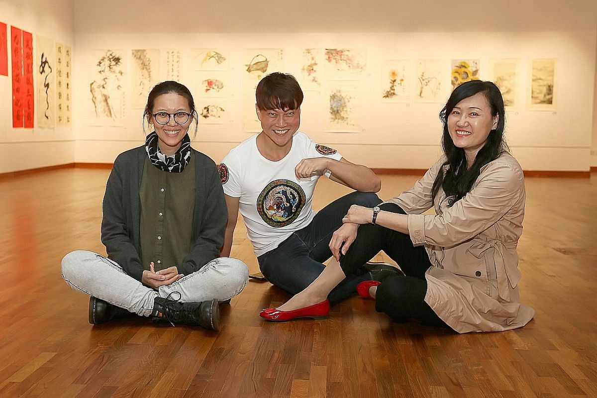 Students majoring in Chinese ink at the Nanyang Academy of Fine Arts include (from far left) Lee Ju-Lyn, Ernest Seah Chien Soo and Ho Seok Kee. Student Nur Hikmah Mohamed Tahir is exhibiting her work, We Are More Than Our Veil, at the school's ongoin