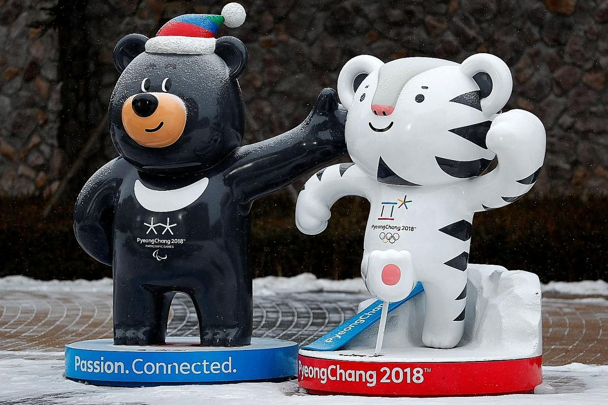 Above, from left: Torchbearers on the road leading to the border truce village of Panmunjom during the Olympic Torch Relay on Jan 19. Ms Hyon Song Wol, head of North Korea's Samjiyon Orchestra which will perform at the Games, arriving in Gangneung in