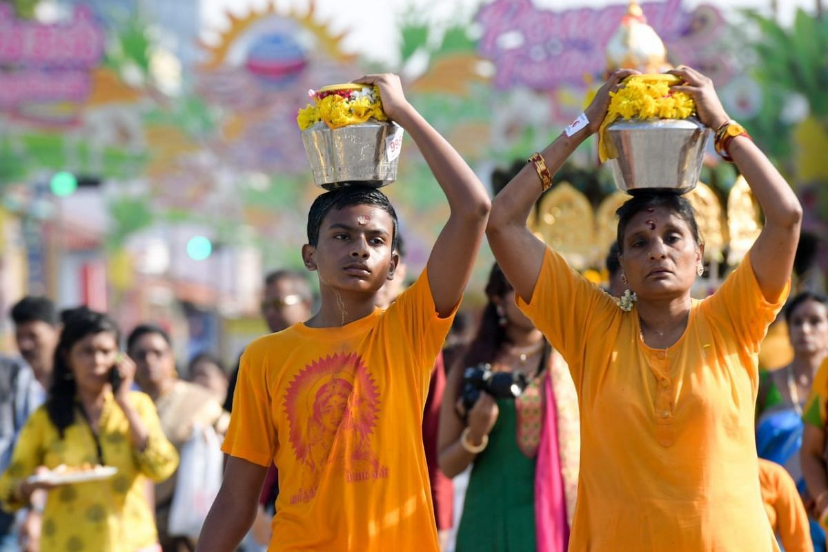 Devotees bearing milk pots during the Thaipusam procession.