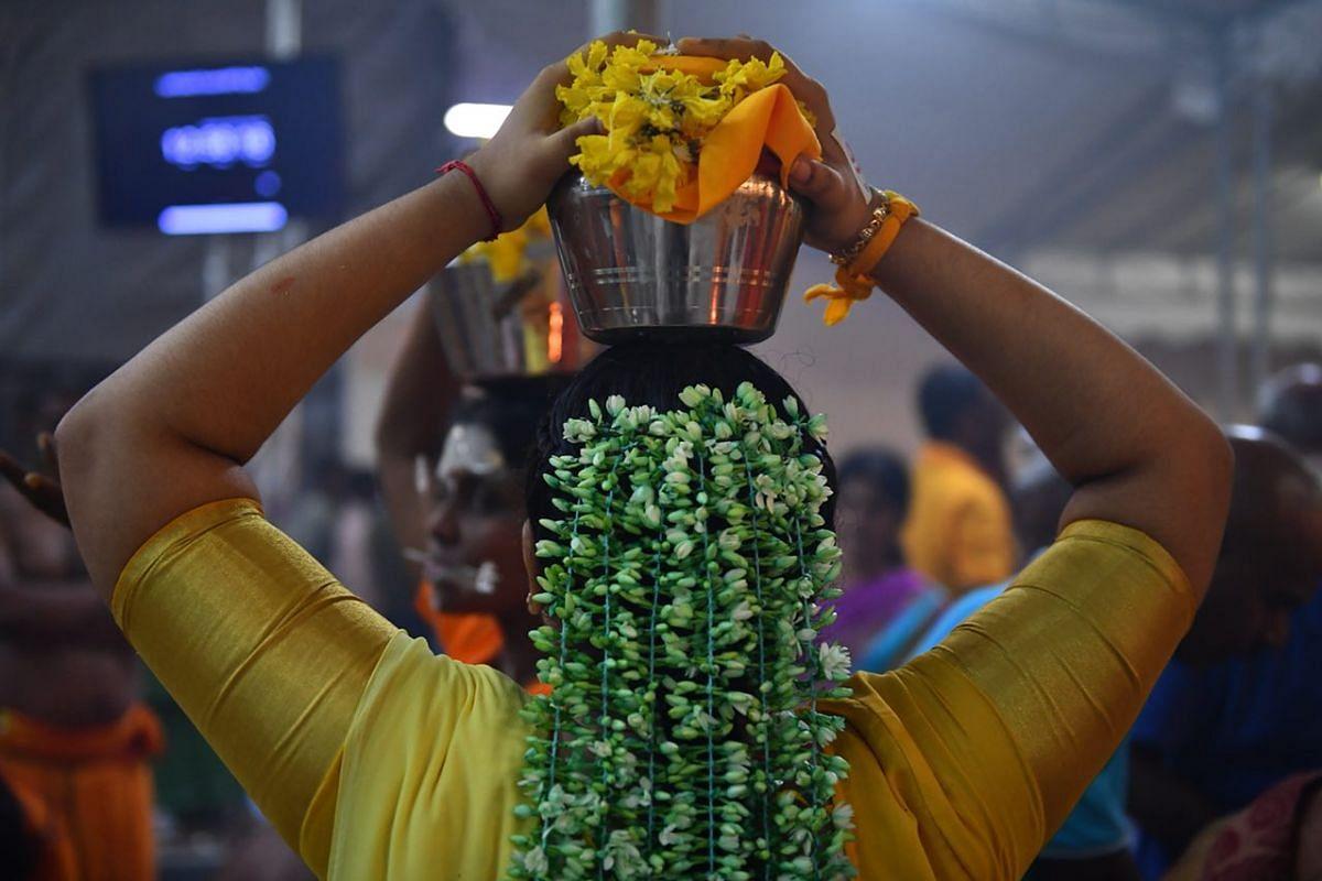 A Paalkudam devotee preparing to leave Sri Srinivasa Perumal Temple.