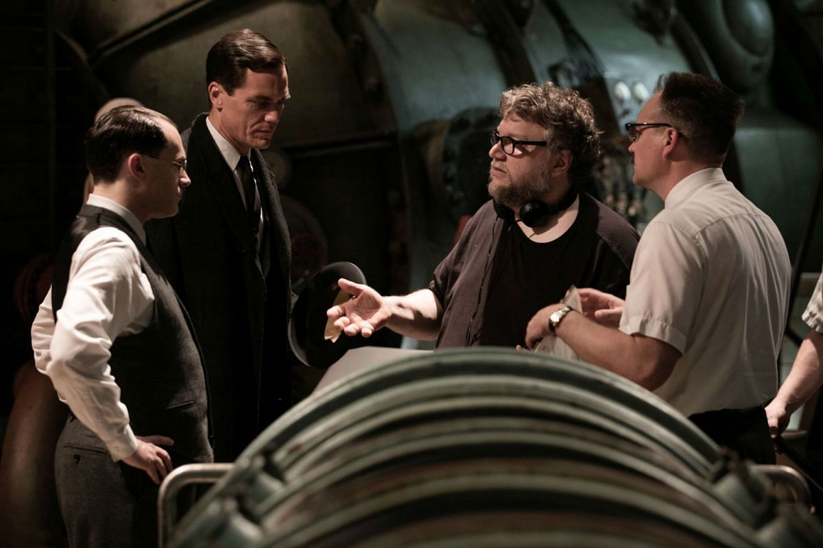 Director Guillermo del Toro (third from left) on the set of The Shape Of Water with actors including Michael Shannon (second from left).