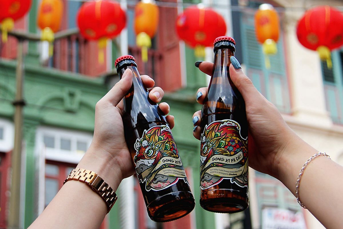 Trouble Brewing's beer for Chinese New Year has bottle labels emblazoned with the design of a dog in a lion dance costume.