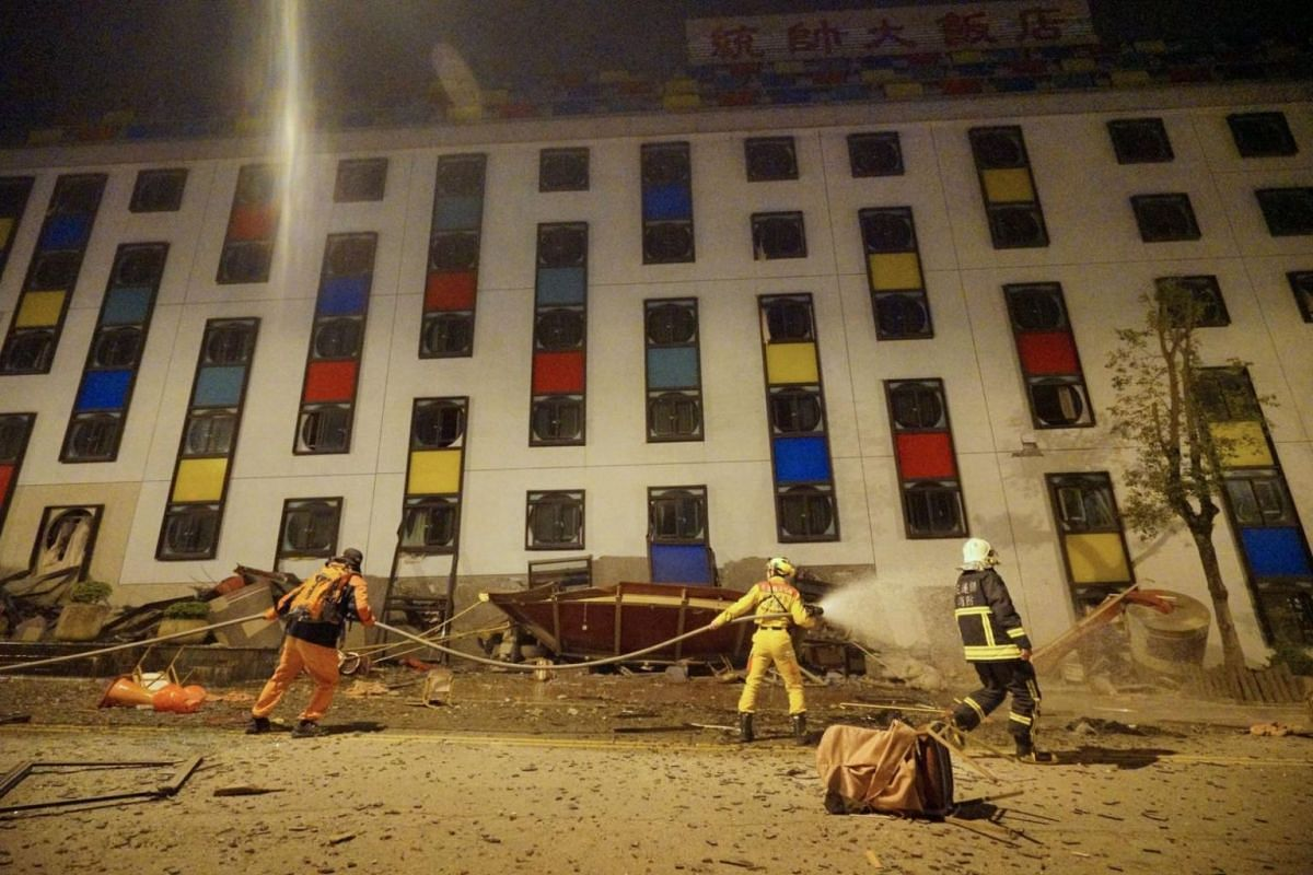 Rescue workers searching the damaged Marshal Hotel in Hualien.