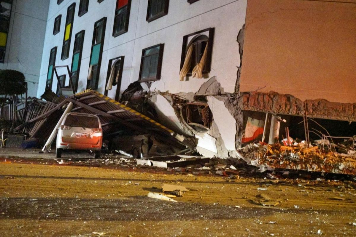 A damaged vehicle in the rubble outside Marshal Hotel.
