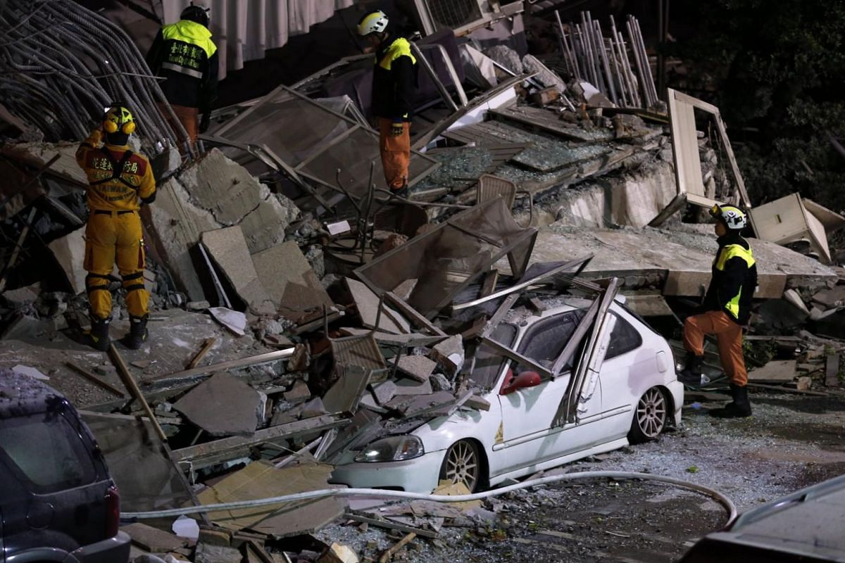 Rescue services search for people in a damaged building in Hualien, eastern Taiwan, following a 6.4 magnitude earthquake on Feb 6, 2018.