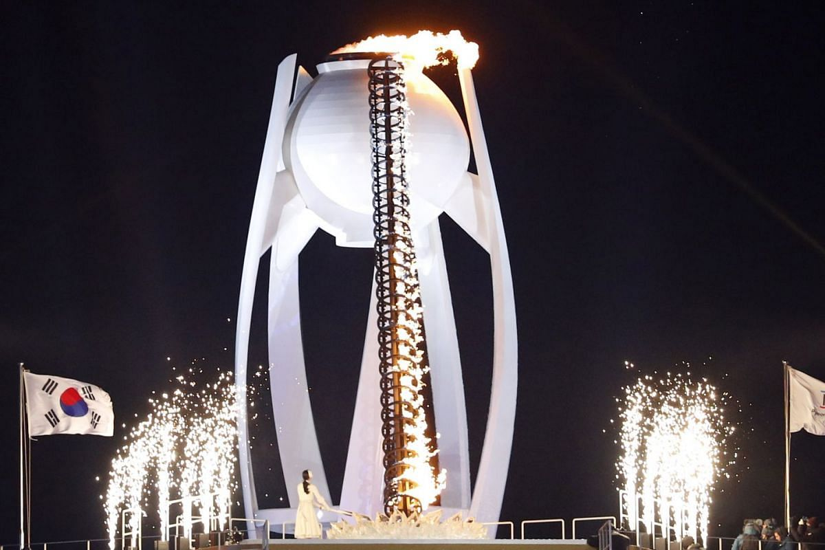 Former South Korean figure skater Yuna Kim lights the cauldron during the opening ceremony of the Pyeongchang Winter Olympics.