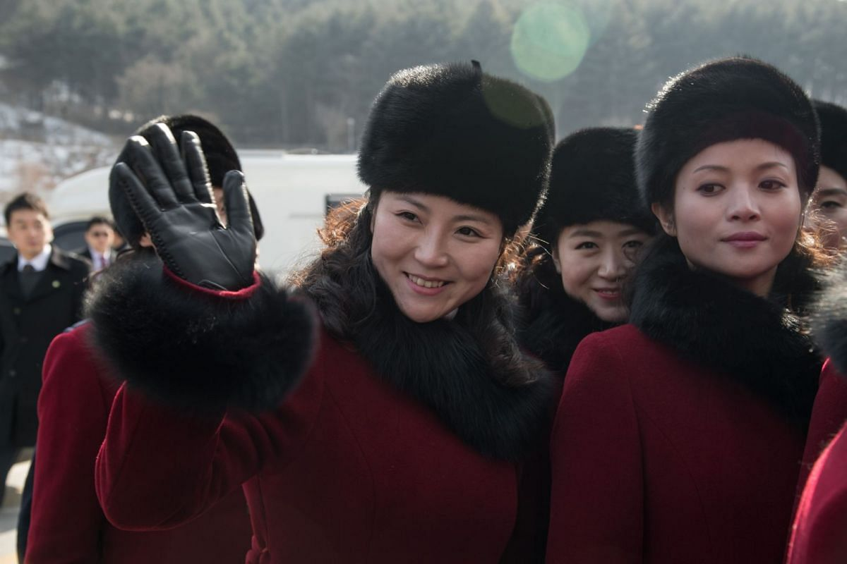 North Korean cheerleaders wave to the media as they arrive at a rest stop, or service station, while on their way to the 2018 Pyeongchang winter Olympic games, on Feb 7, 2018.