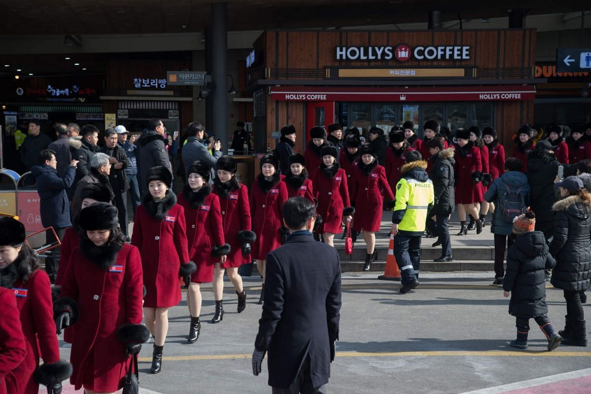 North Korean cheerleaders arrive at a rest stop, or service station, as they make their way to the 2018 Pyeongchang winter Olympic games in a bus convoy carrying a 280-member delegation.