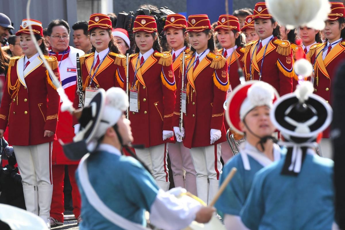 North Korean cheerleaders watching a performance of a South Korean band during a welcoming ceremony for North Korea's Olympic team at the Olympic Village, on Feb 8, 2018.