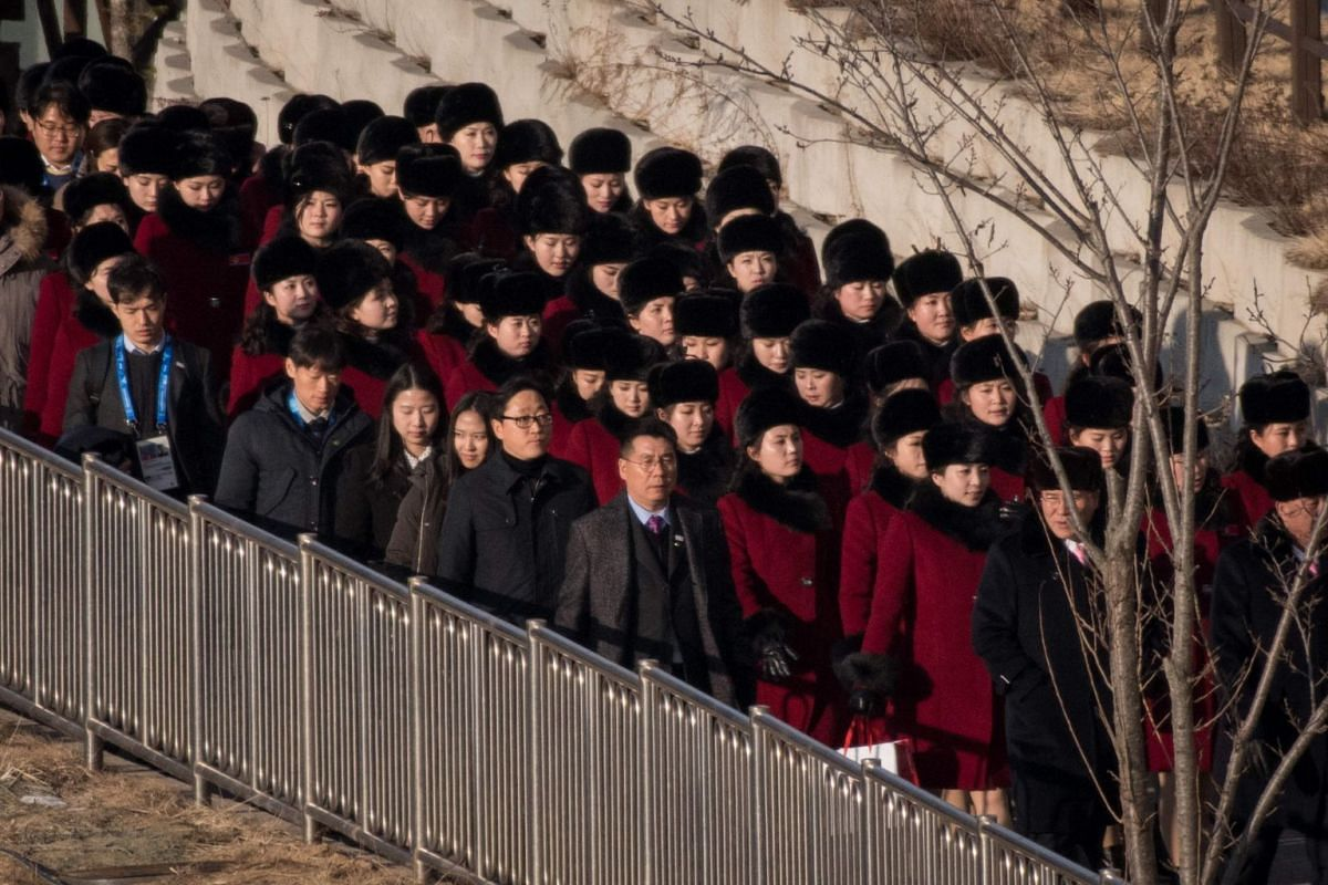North Korean cheerleads walking at the Inje Speedium resort complex, where they are staying during the 2018 Pyeongchang winter Olympic games.