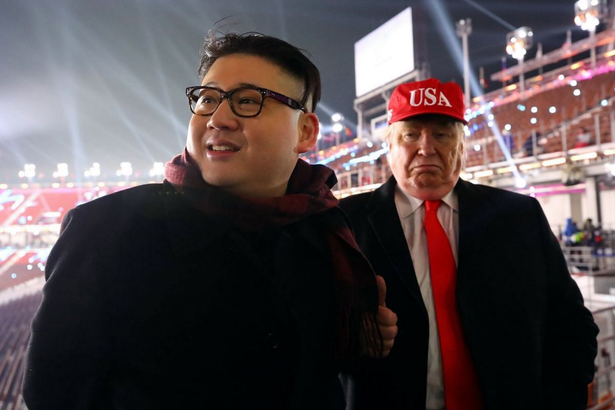 Men dressed up as US President Donald Trump and North Korean leader Kim Jong Un attend the opening ceremony of the Pyeongchang Winter Olympics.