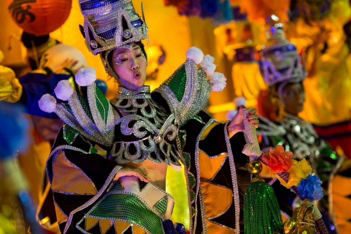 A performer donning a specially-designed outfit and headgear at the carnival.