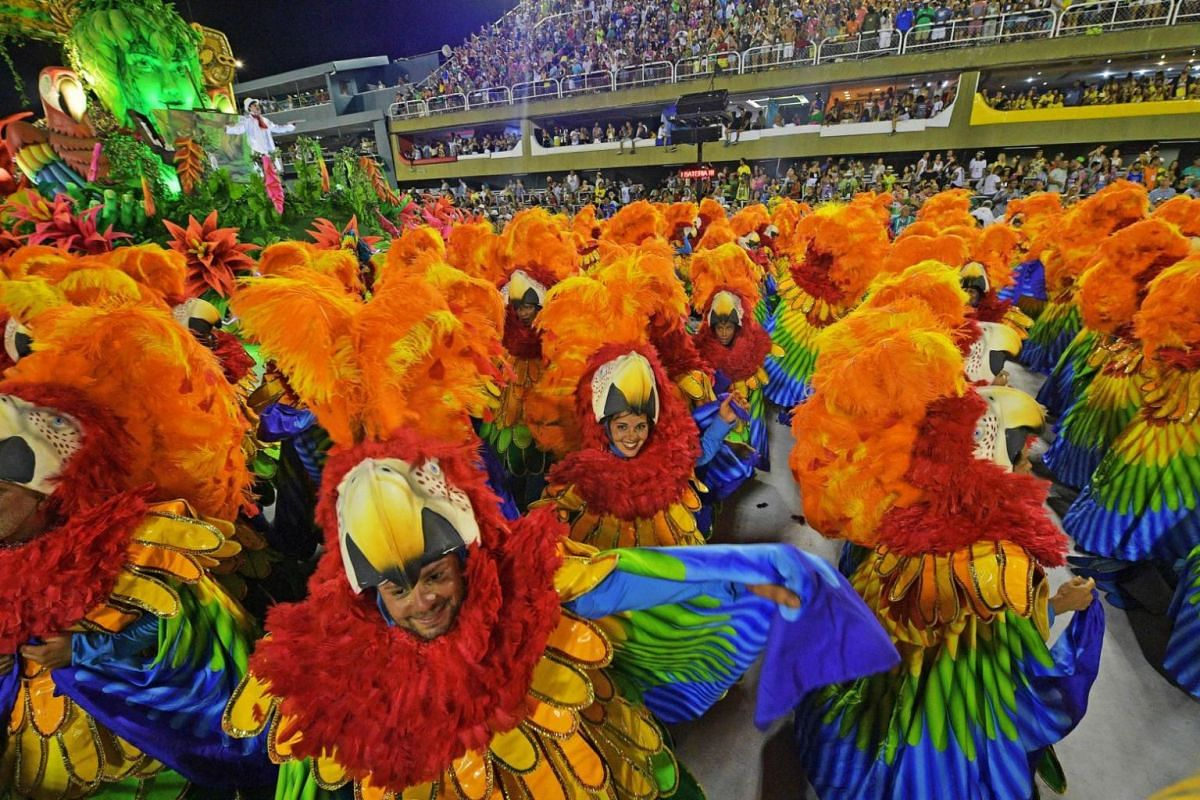 Revellers of the Sao Clemente clad in colourful outfits as they go about with their routines during a performance.