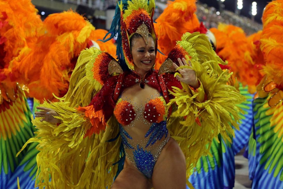 A reveller from the Sao Clemente Samba school performs during the first night of the carnival parade.