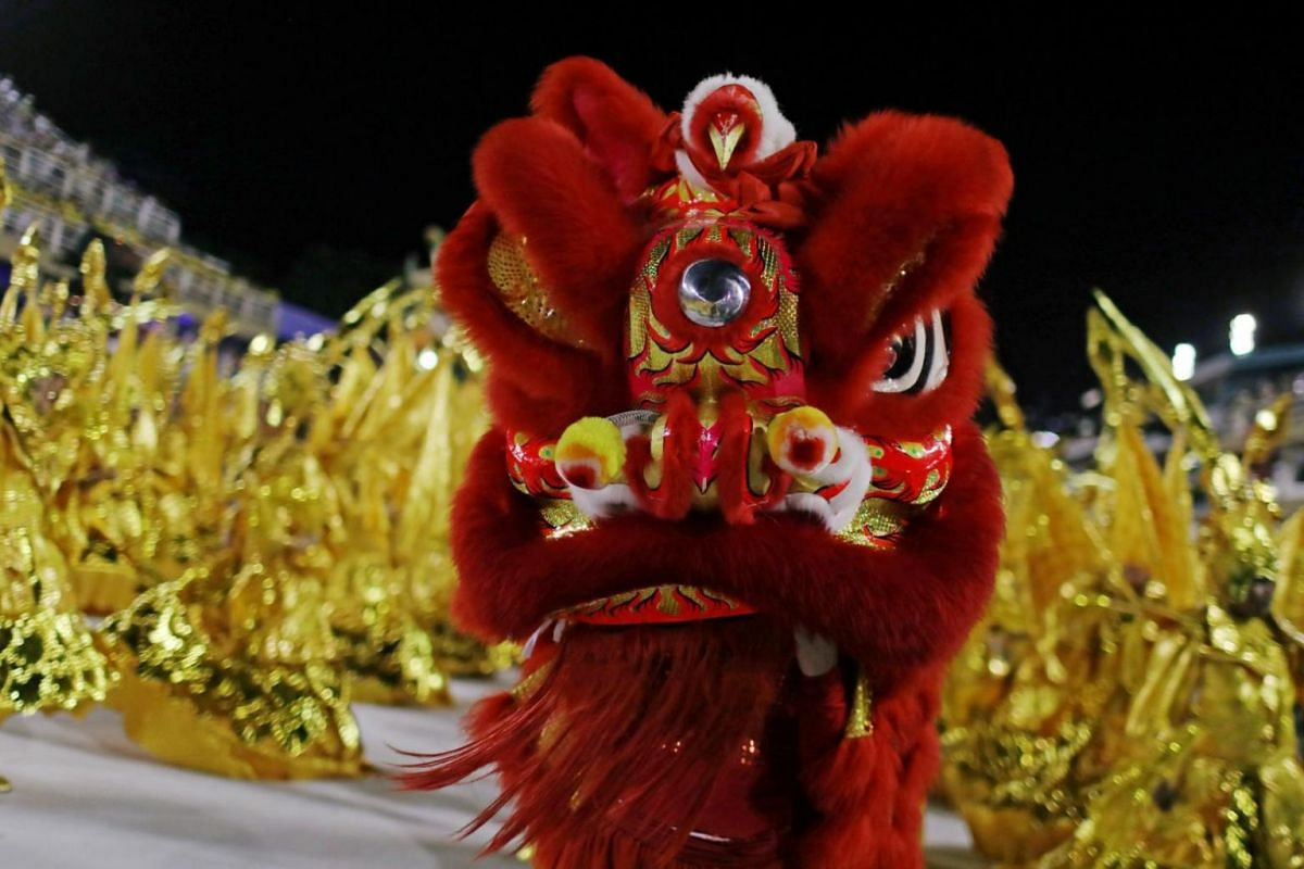 Performers in a lion dance outfit showing off their moves at the Rio Carnival.