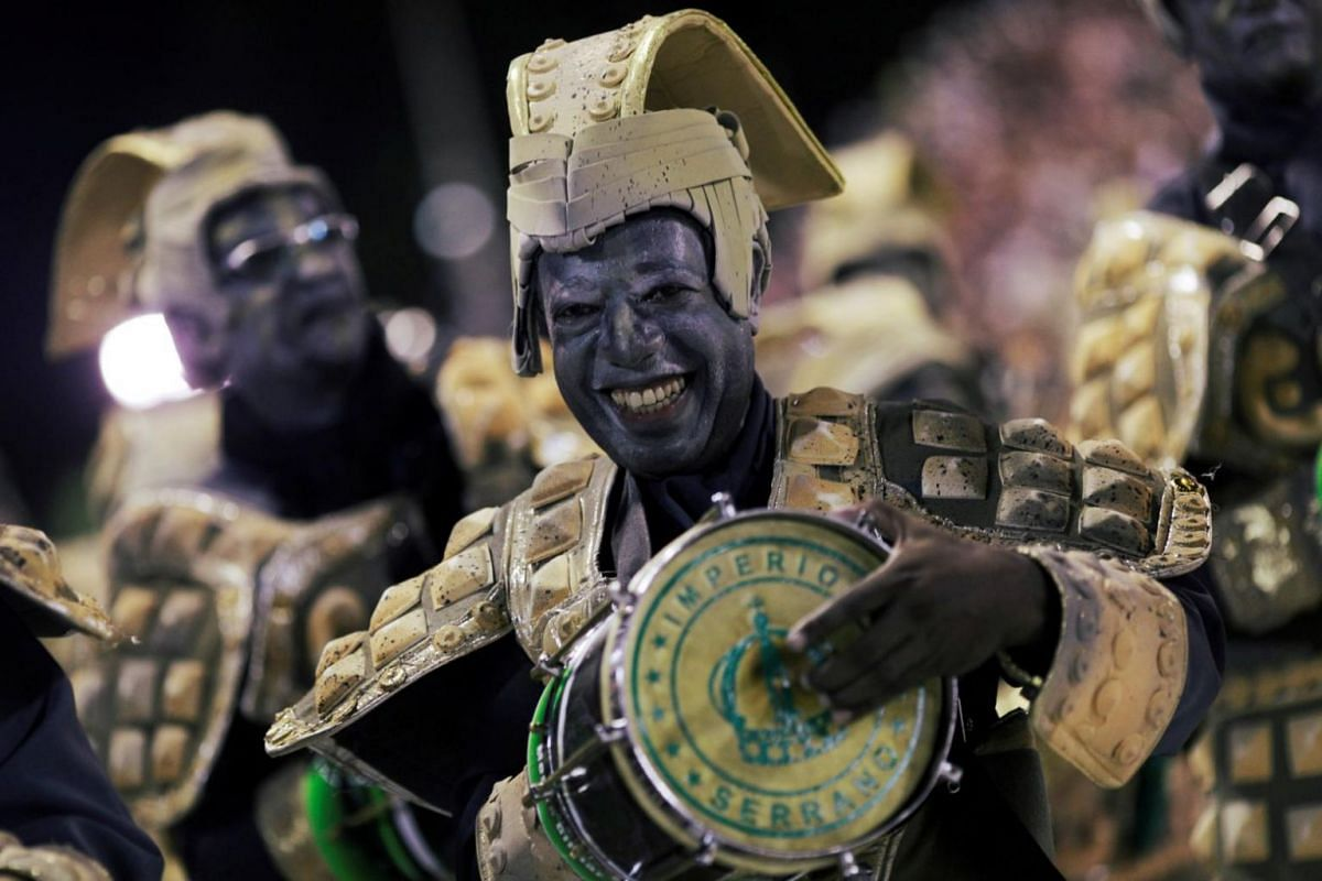 A reveller from the Imperio Serrano samba school performs during the first night of the Carnival parade.