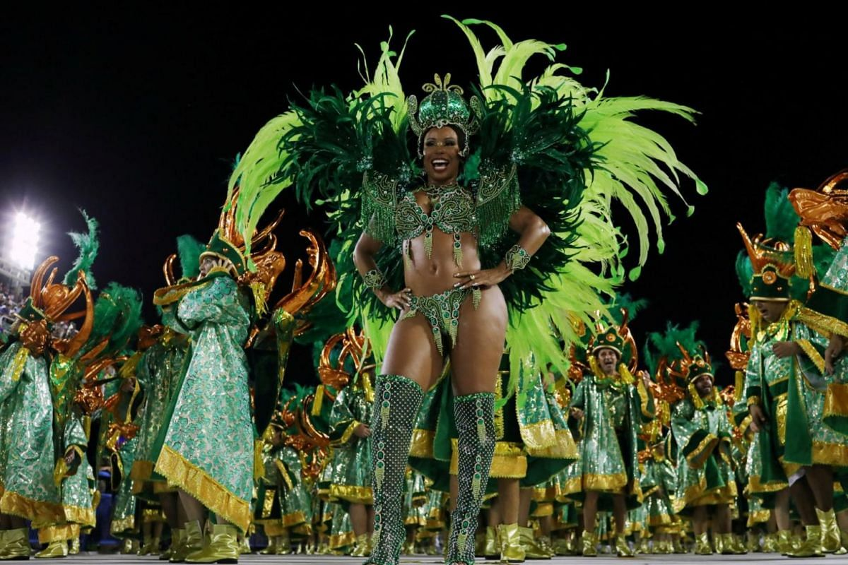 A female performer clad in a stunning green outfit at the parade.