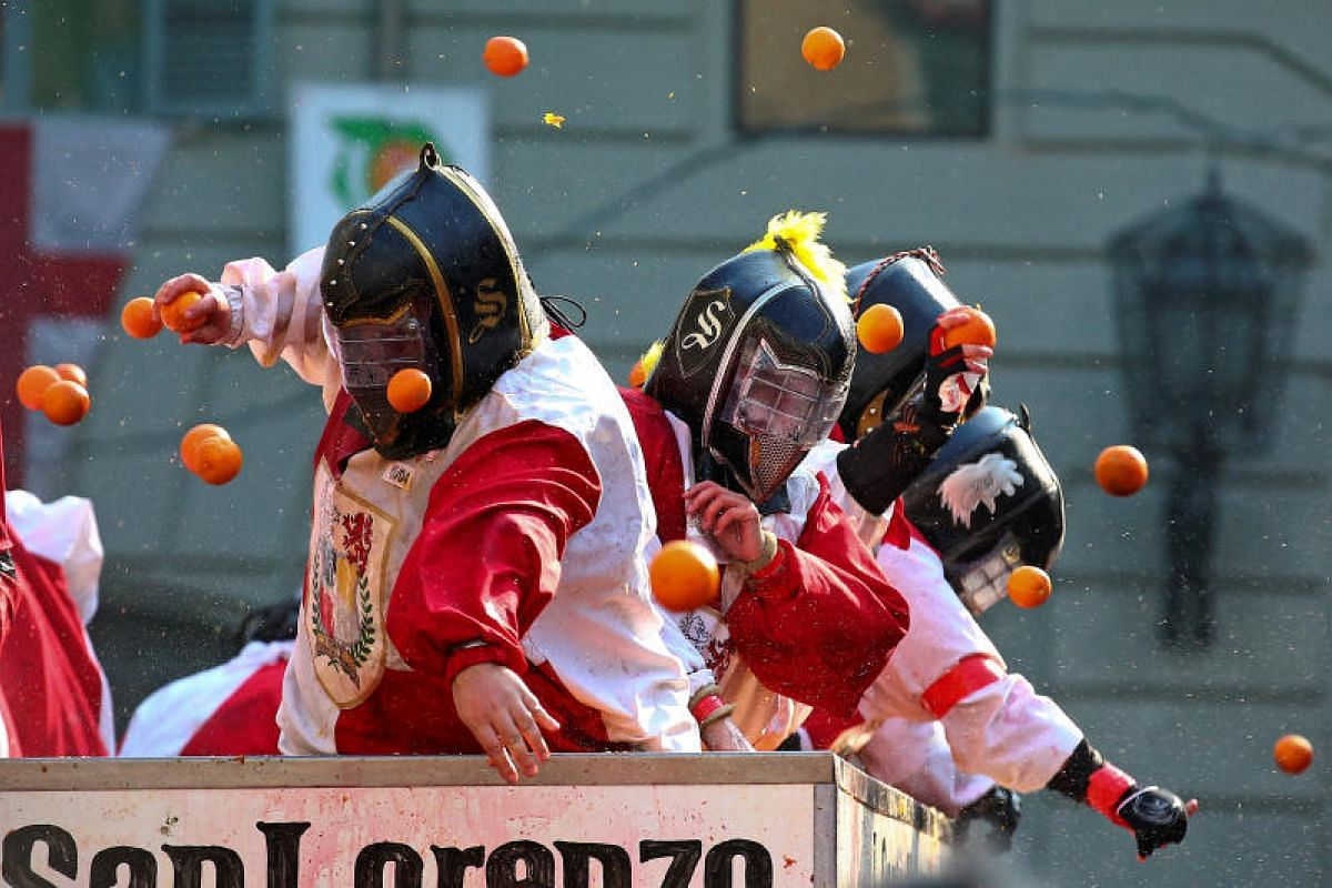 Members of rival teams fight with oranges during an annual carnival battle in the northern Italian town of Ivrea, Italy, on Feb 11, 2018.