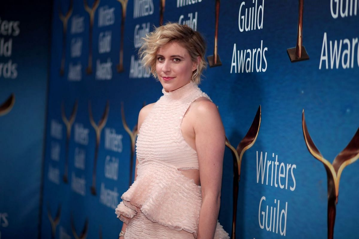 Writer-director of Lady Bird Greta Gerwig, who is the fifth woman to be nominated for a Best Director Oscar, arrives at the Writers Guild awards red carpet.