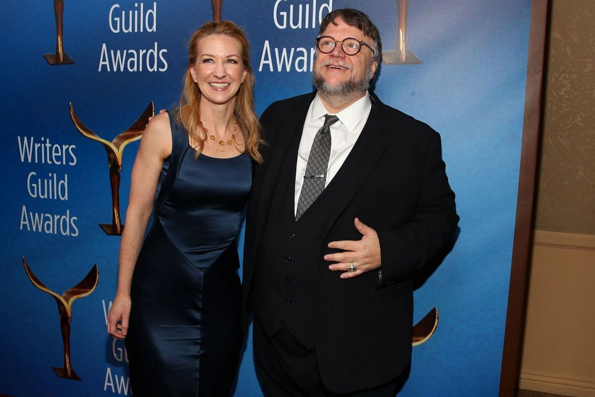 Writer-directors Vanessa Taylor and Guillermo del Toro pose on the red carpet for the Writers Guild awards.