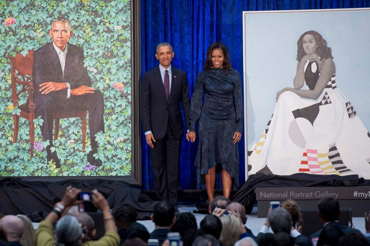 Former US President Barack Obama and First Lady Michelle Obama stand beside their portraits after their unveiling at the Smithsonian's National Portrait Gallery in Washington, DC, February 12, 2018. PHOTO: AFP