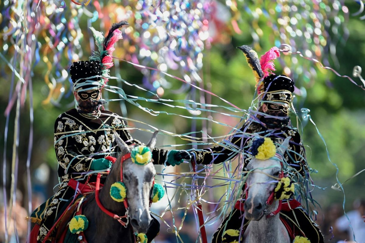Revellers participate in the traditional carnival on horseback in Bonfim, Minas Gerais state, southeastern Brazil, on February 12, 2018. PHOTO: AFP