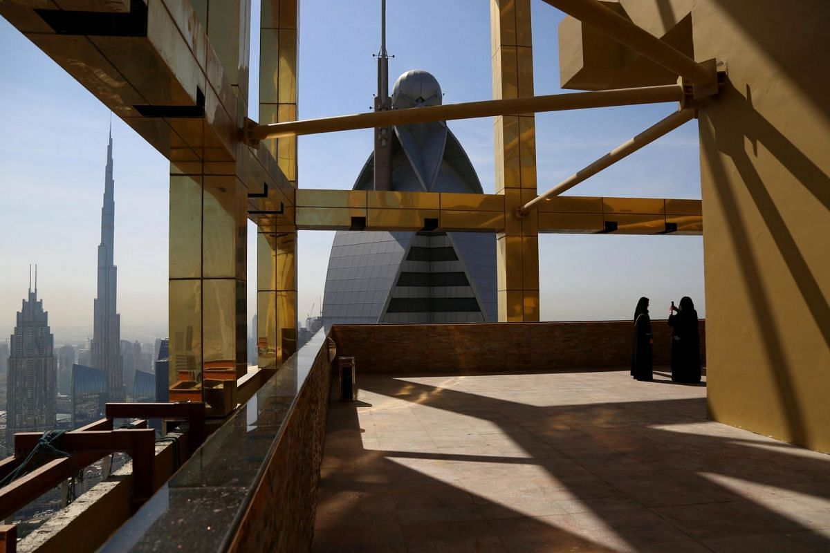 A visitor takes photos at the 71st floor of the Gevora Hotel, the world's tallest hotel, in Dubai, UAE February 12, 2018. PHOTO: REUTERS