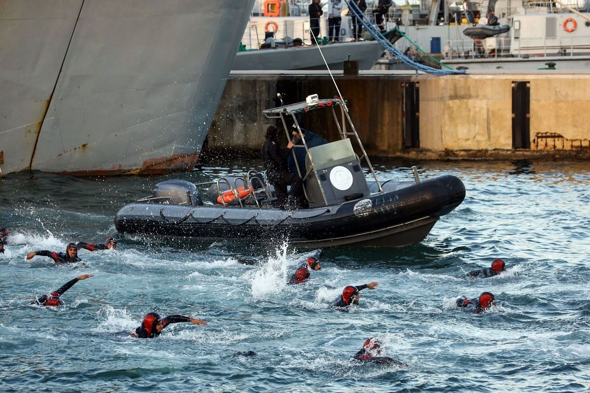 Libyan cadets perform naval drills during a graduation ceremony for a new batch of the unity government's Special Operations Force, at Abu Sitta Naval Base in the capital Tripoli on February 13, 2018. PHOTO: AFP