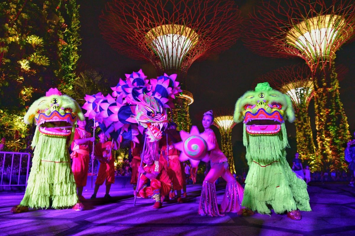 The traditional lion and dragon dance took on a modern twist at the Gardens by the Bay on February 13, 2018, as dancers pranced about the Supertree Grove aglow with ultraviolet light. PHOTO: THE STRAITS TIMES/DESMOND WEE