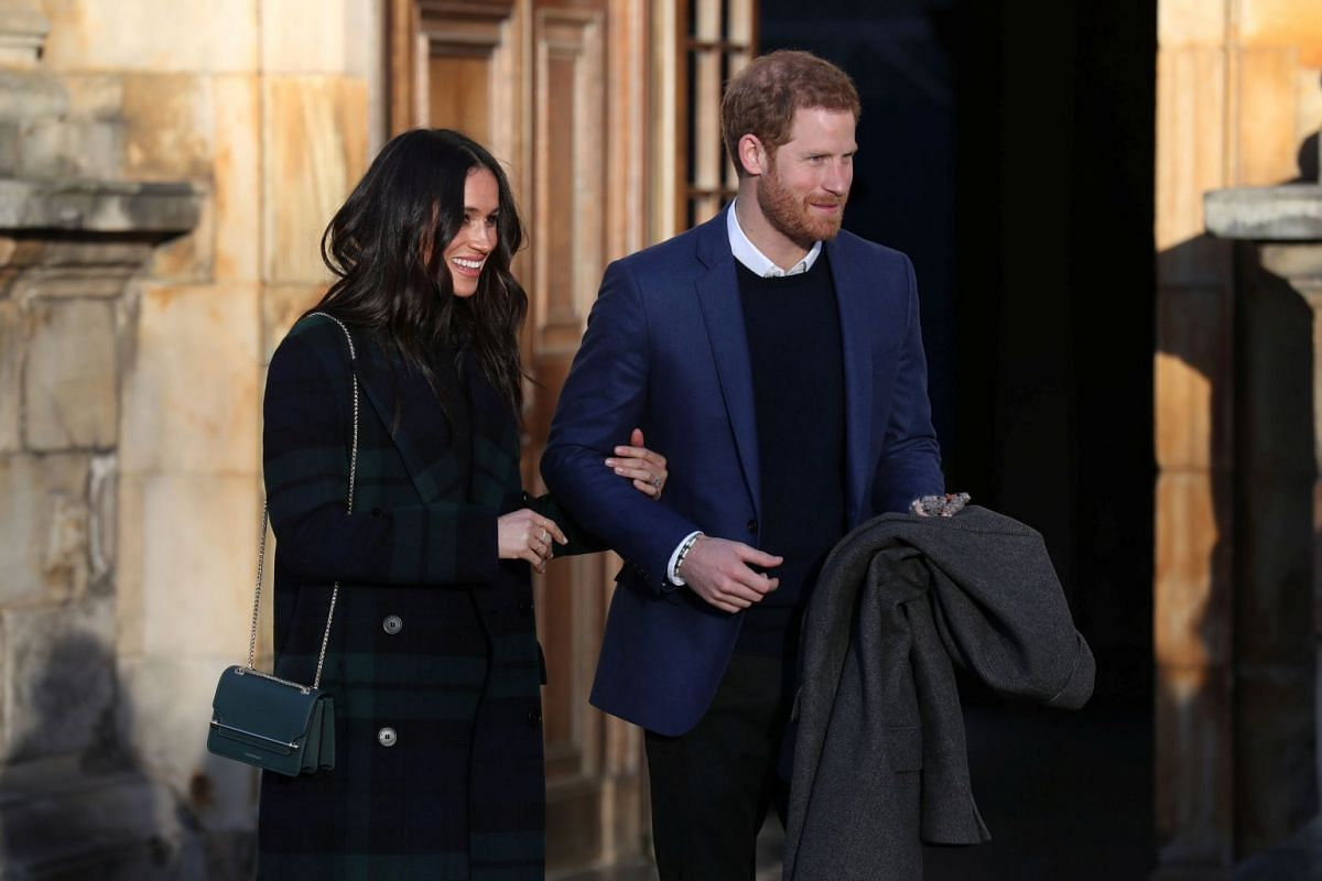Britain's Prince Harry and his fiancee Meghan Markle attend a reception for young people at the Palace of Holyroodhouse in Edinburgh, Britain February 13, 2018. PHOTO: REUTERS