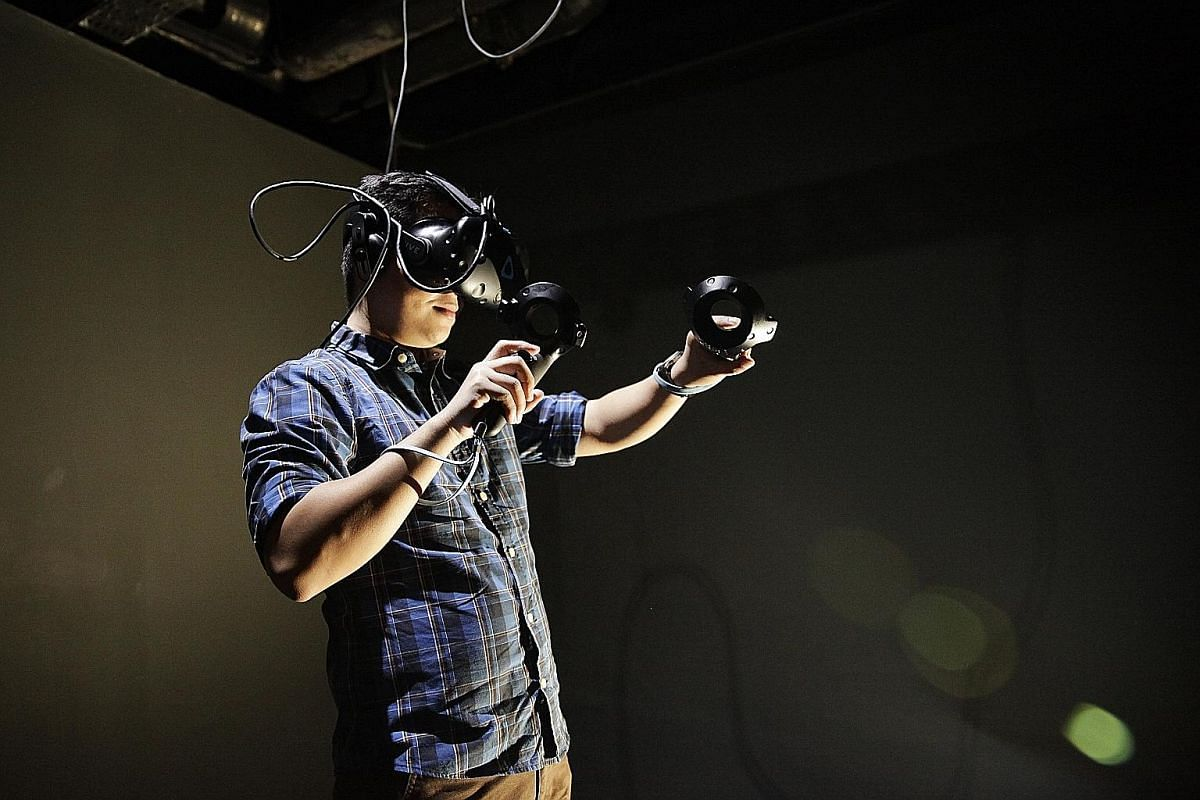 At Virtual Room Singapore, players don headsets (above) to enter its virtual-reality games and solve puzzles as a team.