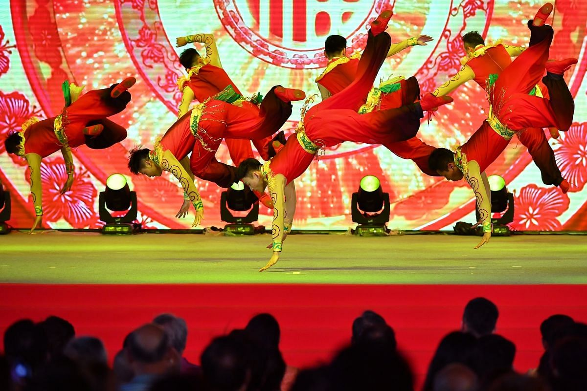 Members of the Anhui Chuzhou Performing Arts Group dancing on stage during the opening of this years River Hongbao extravaganza.