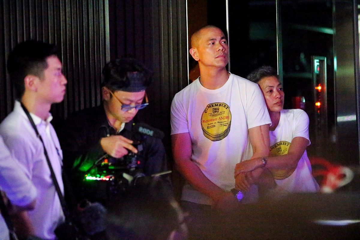Chef Andre Chiang (centre) and his wife Sudarampai Chiang (right) watch the video they prepared for the media.