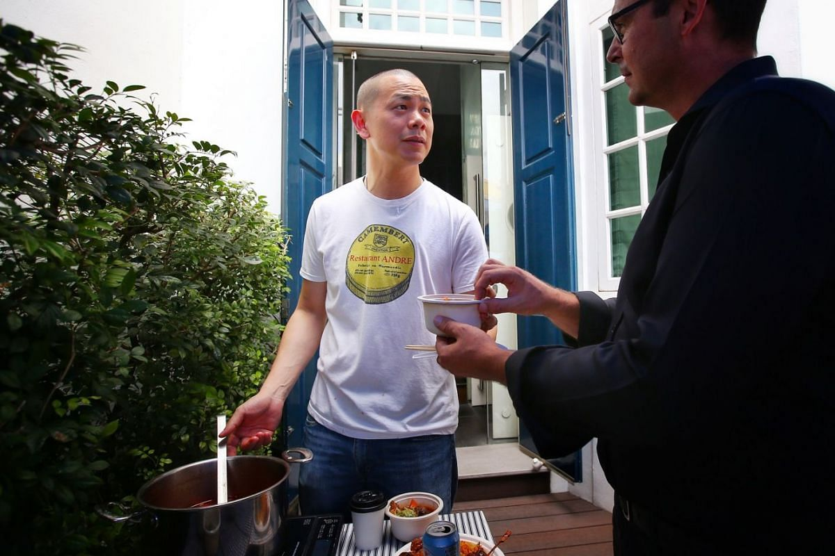 Chef Andre Chiang serves his Taiwanese beef noodle dish to guests.