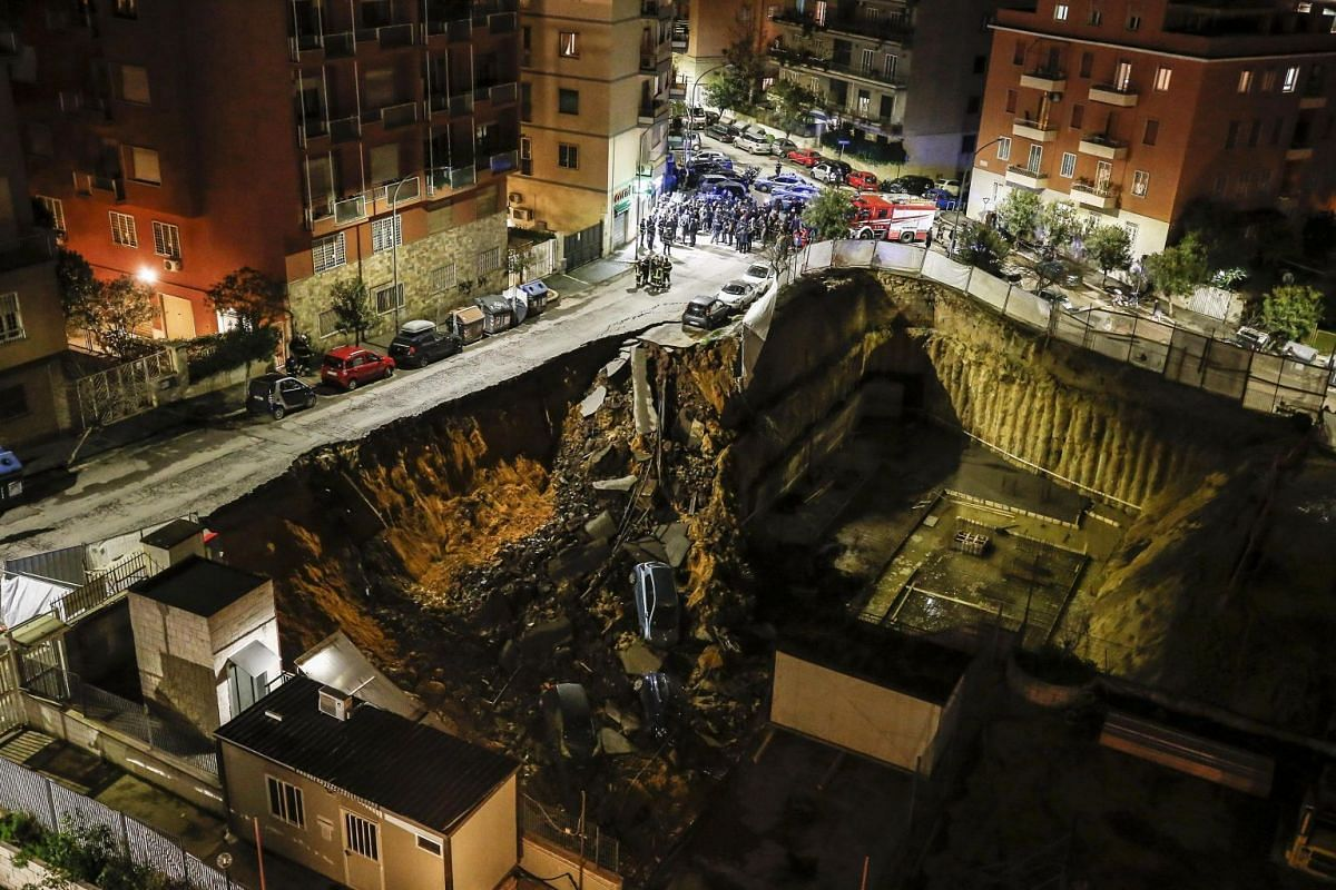 A general view of a chasm that opened in the street and swallowed some parked cars in the Balduina neighborhood in Rome, Italy on 14 February 2018. PHOTO: EPA-EFE