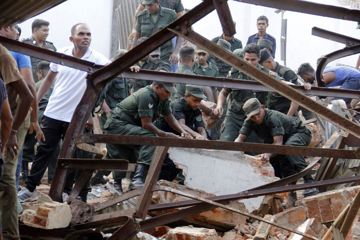 Sri Lankan Army officers remove rubble at the site of a collapsed storehouse in Colombo on February 14, 2018. PHOTO: AFP
