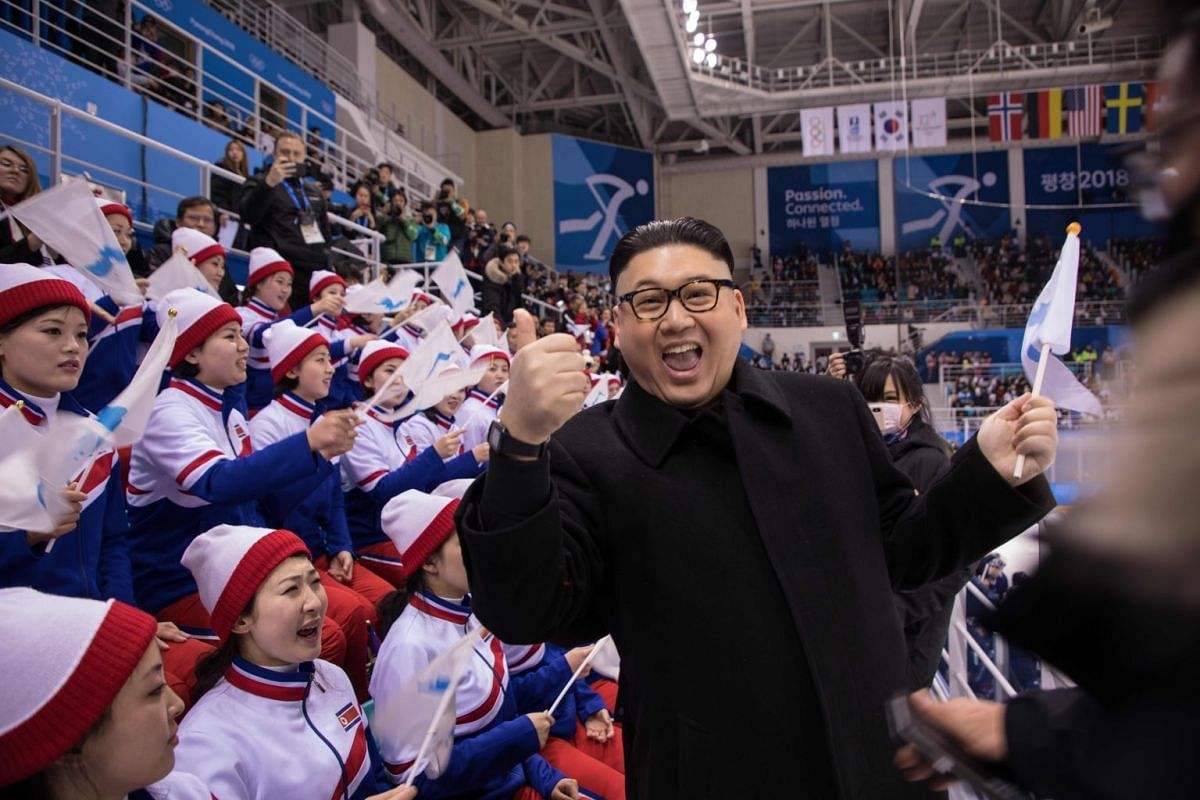 A man impersonating North Korean leader Kim Jong Un gestures as he stands before North Korean cheerleaders attending the Unified Korean ice hockey game against Japan during the Pyeongchang 2018 Winter Olympic Games at the Kwandong Hockey Centre in Ga