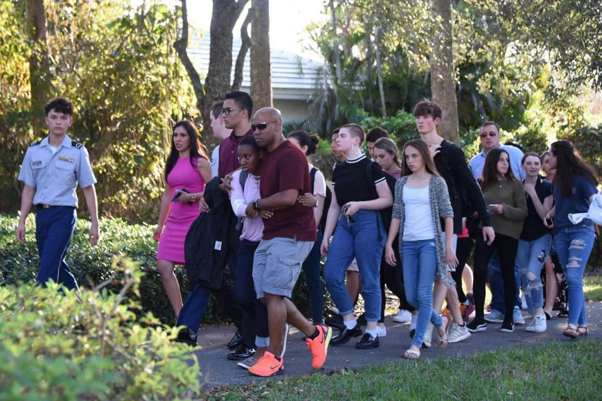 A group of students walking away from the scene of the shooting.